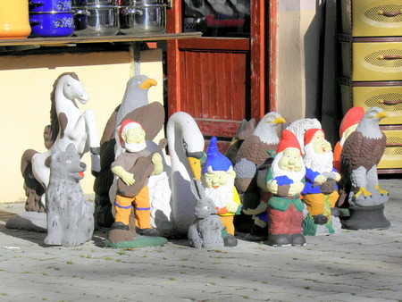 dwarfs: Garden dwarfs and the other popular colourful figures showing themselfs in front of a store. Stock Photo