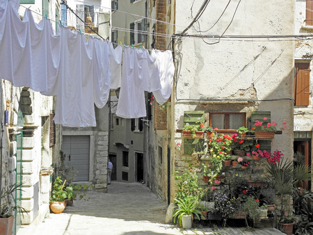 washed: Rovinj, streets with drying the washed textile , 8 Stock Photo