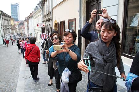 enyoing: Korean tourists enyoing Kravatas day,Zagreb,1