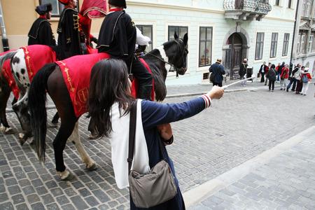 enyoing: Korean tourists enyoing Kravatas day,Zagreb,3 Editorial