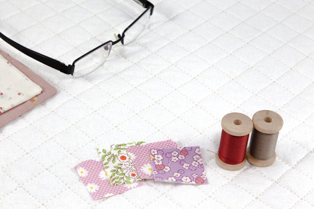 patchwork quilt: accessory needlework put on white patchwork Quilt background