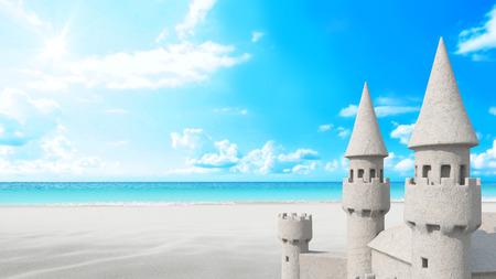 Sandcastle beach on bright blue sky background Archivio Fotografico