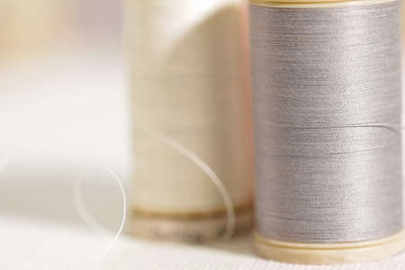 Thread closeup on white fabric