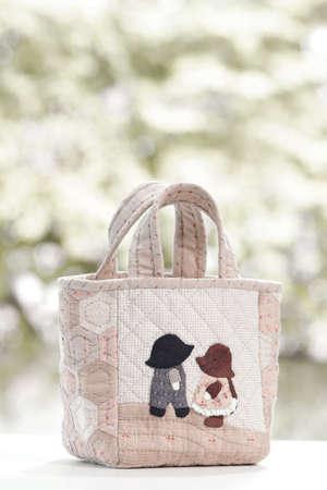 Quilt bag handmade craft on garden background