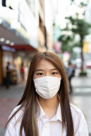 Girl wearing mask  at shopping center street