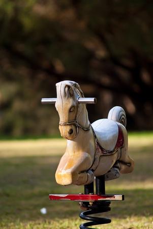 White Rocking horse on the playground  photo