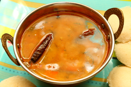 Idly with sambar Iddli is a traditional breakfast of South Indian households,its a very popular savory dish of South Indian cuisine. photo