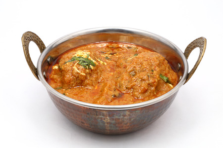 indian food: indian food in brass bowl Stock Photo