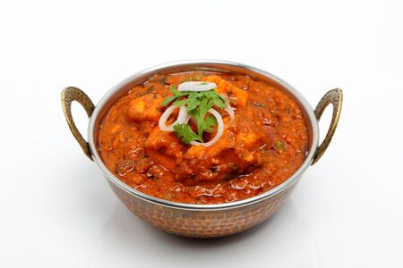 Indian Food or Indian Curry in a copper brass serving bowl.
