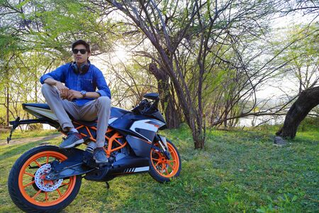 Stylish male model with motorcycle or sports bike