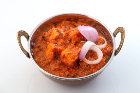 Indian style food or Indian Curry in a copper brass bowl.