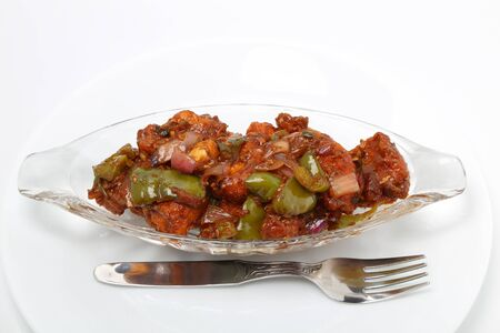 Indian food or Chinese food. Chicken with sweet and sour sauce.