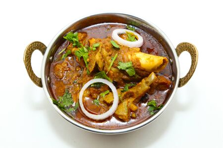 Indian meat dish or mutton curry in a copper brass bowl. Reklamní fotografie