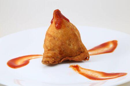 Samosa with sauce or chutney