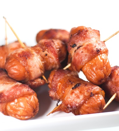 Sausages wrapped in bacon Stock Photo - 20498442