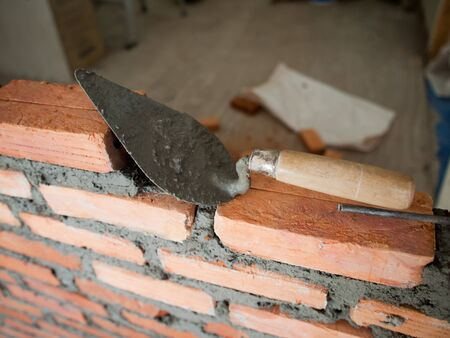 Trowel on construction site photo