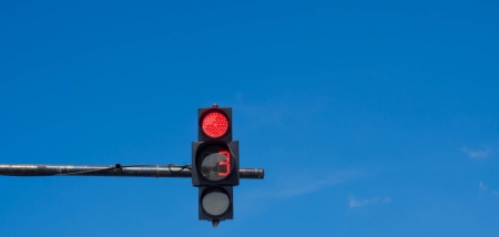 traffic light with a beautiful blue sky photo