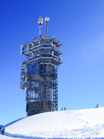 Communication tower on top of mount Titlis, in Switzerland photo