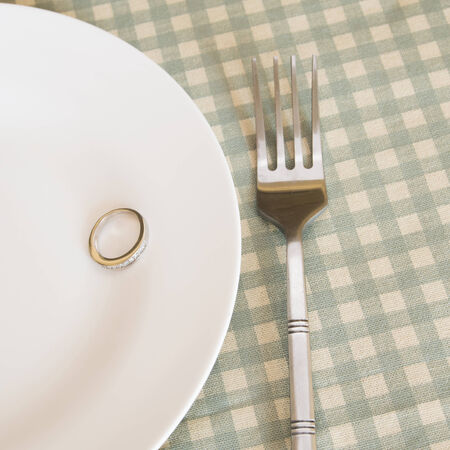 wedding rings on plate with fork