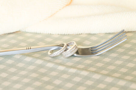 wedding rings and fork photo