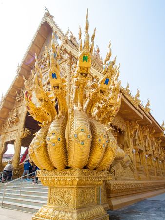 naga china: Golden king of Naga with sky at public temple Stock Photo