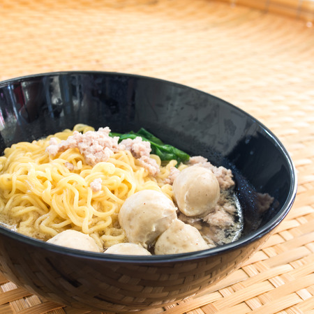Eating instant noodle with minced pork and pork ball