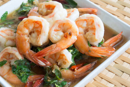 Thai food, shrimp ,with chili pepper and sweet basil. photo