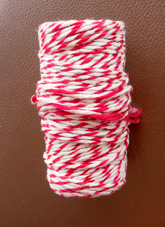 Roll of red and white rope