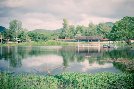 pavilion at a pond in nature scene.