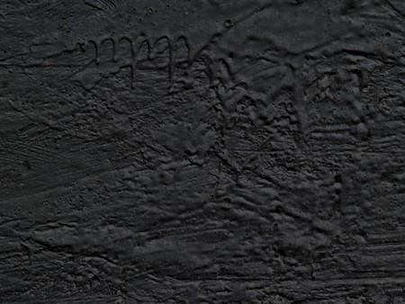 Schwarzer Harz setzen auf eine Ebenheit f�r einen Hintergrund
