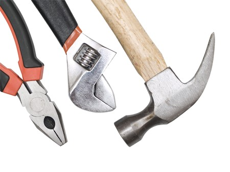 hammer, pliers, wrench on a white background
