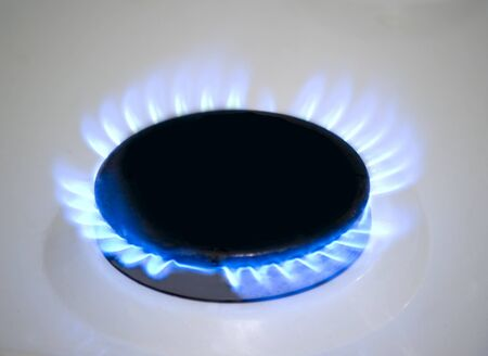 blue flame on a gas stove included Stock Photo