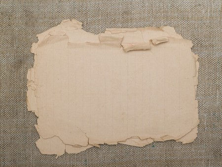 very old yellowed paper on an old cloth background Stock Photo - 7766480