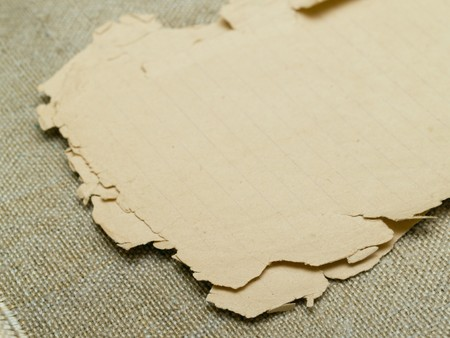 very old yellowed paper on an old cloth background Stock Photo - 7766396