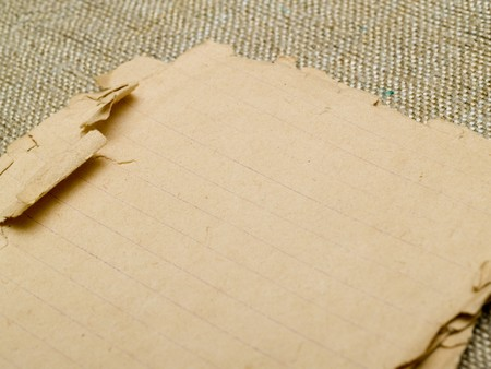 very old yellowed paper on an old cloth background Stock Photo - 7766399