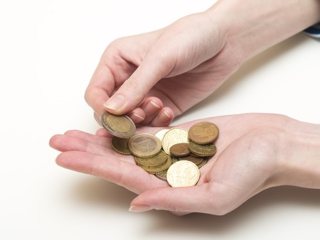 punhado: handful of euro coins in womens hands Banco de Imagens