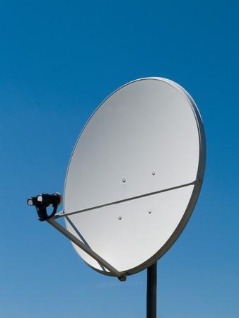 parabolic antenna on a background of blue sky photo