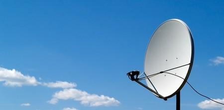 parabolic antenna on a background of blue sky