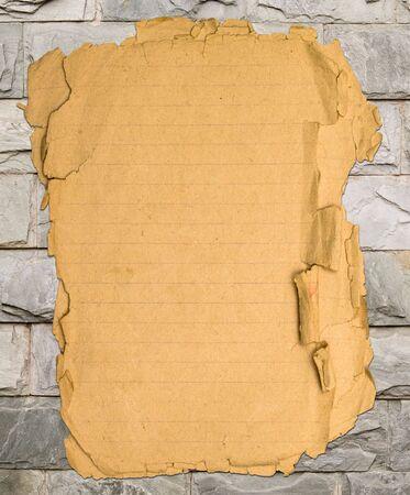 Old paper on decorative bricks photo