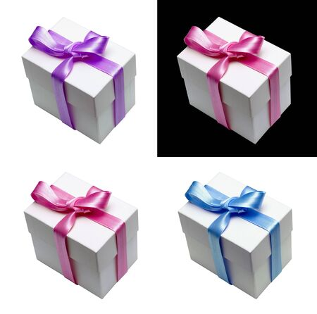 Gift box tied with satin ribbon in four different colors photo