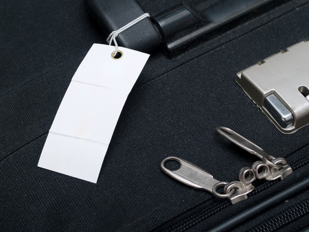 label tied to the handle of a suitcase