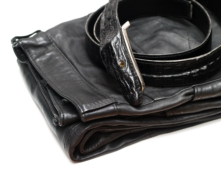 Schwarze Lederhose und ein schwarzer Lederg�rtel isolated on white background Lizenzfreie Bilder