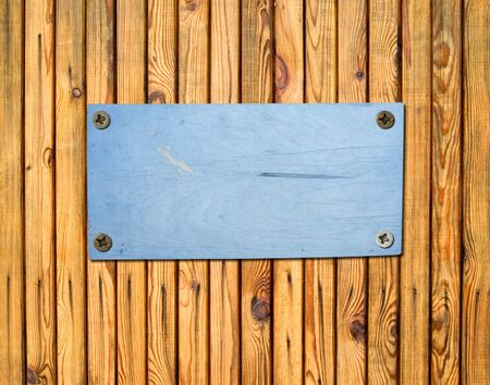 bolted: empty plywood sign bolted to a wooden wall