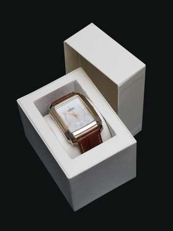 gold watch in a box on a dark blue background Stock Photo