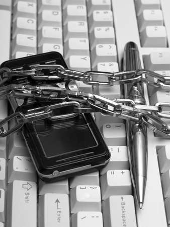 mobile phone keyboard and a pen tied chain photo