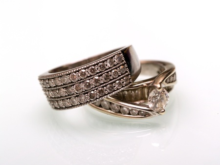 two golden wedding rings with stones