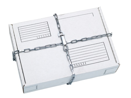 white parcel wrapped in a chain on white Stock Photo