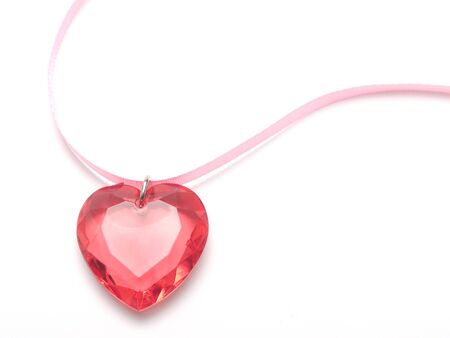 pink heart of stone with a pink ribbon on a white Stock Photo
