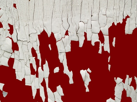 flaky: old cracked white paint on red background