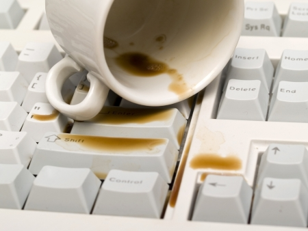 poured a cup of coffee on the keyboard